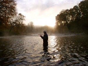 Angler and early morning fog on the Tuckasegee River