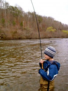 Jadon fighting a nice rainbow on the Tuckasegee River
